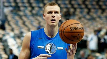 Mavericks forward Kristaps Porzingis practices before a game