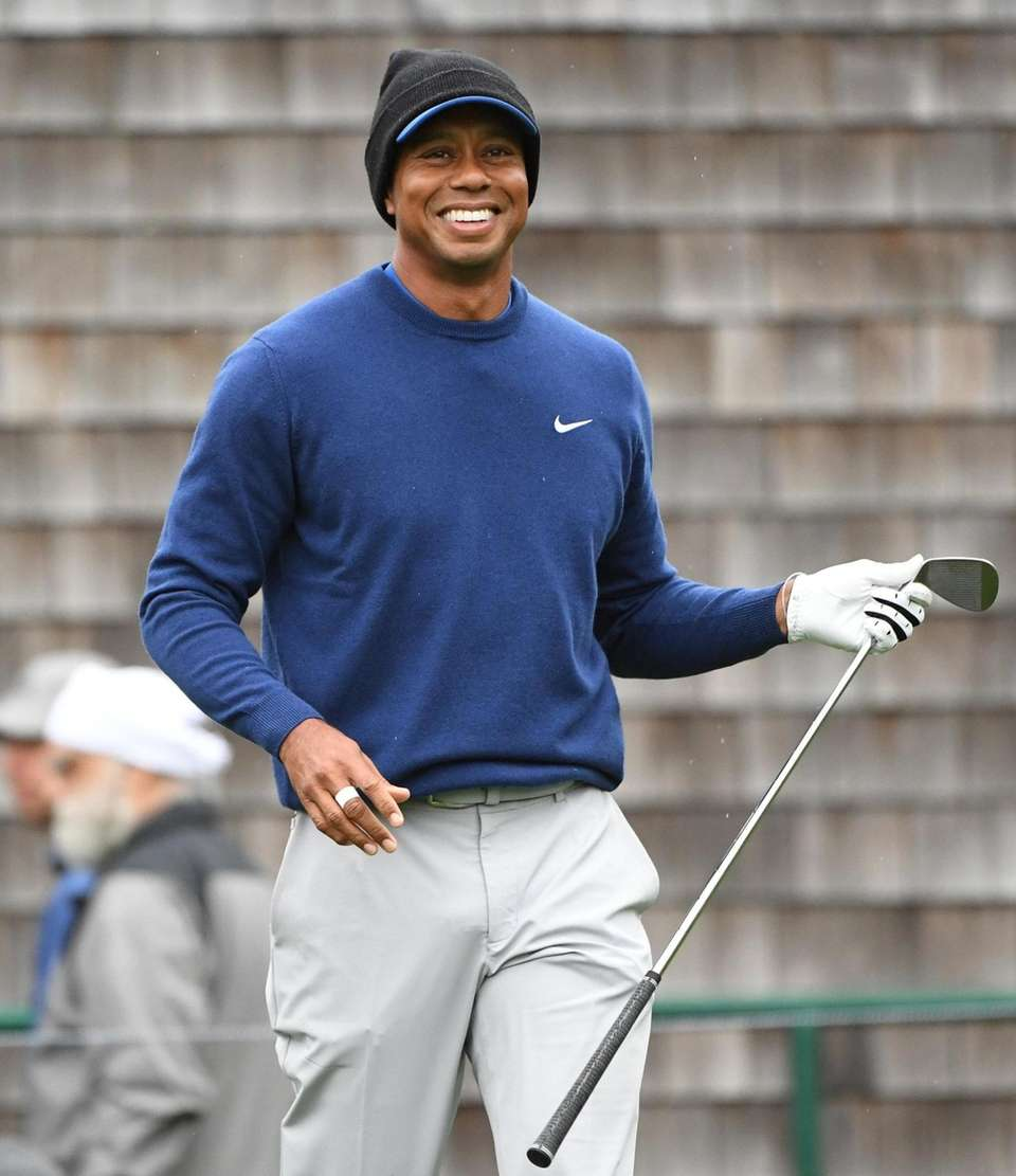 Tiger Woods reacts on the course during the