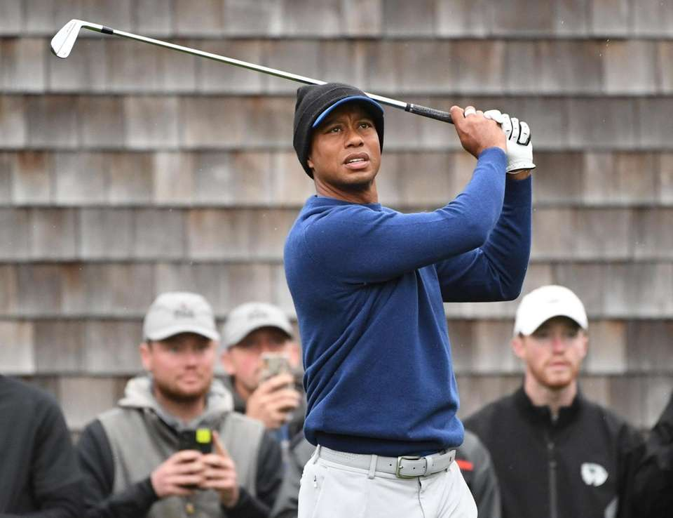 Tiger Woods watches his tee shot during the