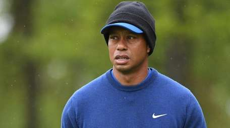 Tiger Woods looks on from the course during