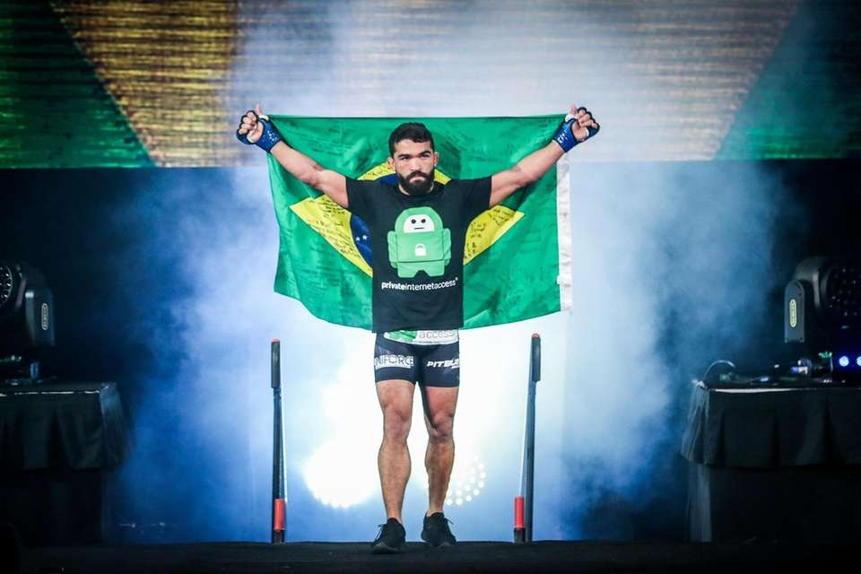 Patricio Freire walks to the cage to face