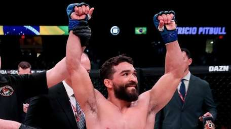 "Patricio ""Pitbull"" Freire celebrates his win over Michael"