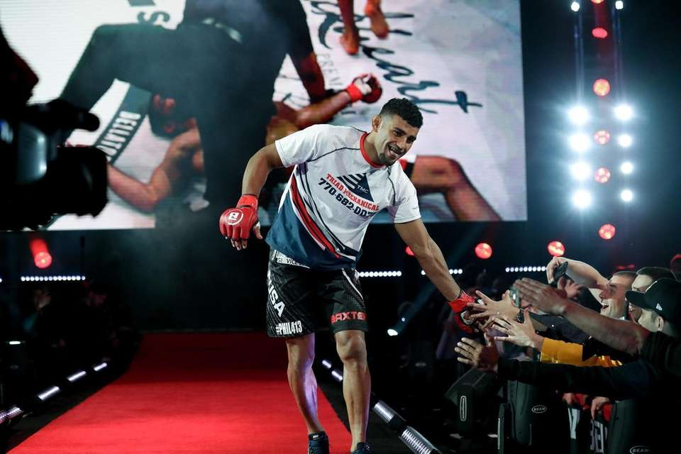 Douglas Lima heads to the cage to face