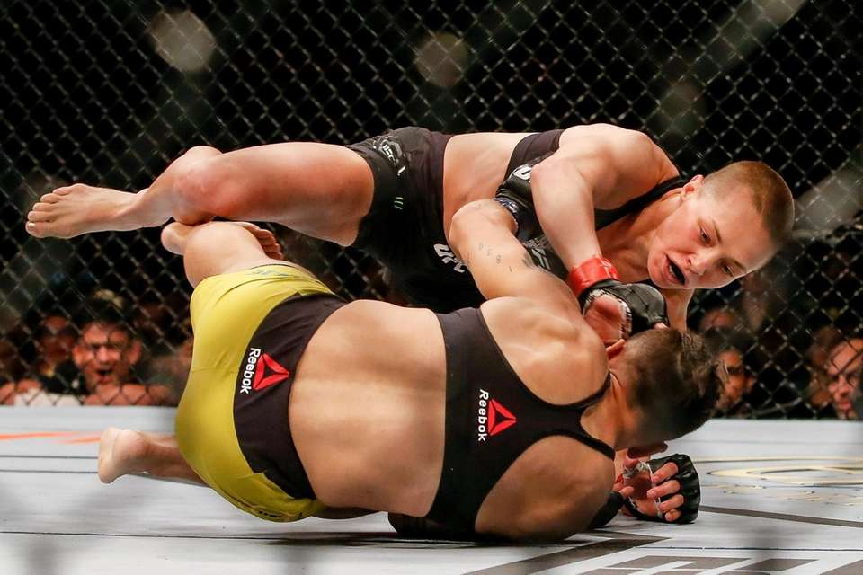 Rose Namajunas punches Jessica Andrade in their women's