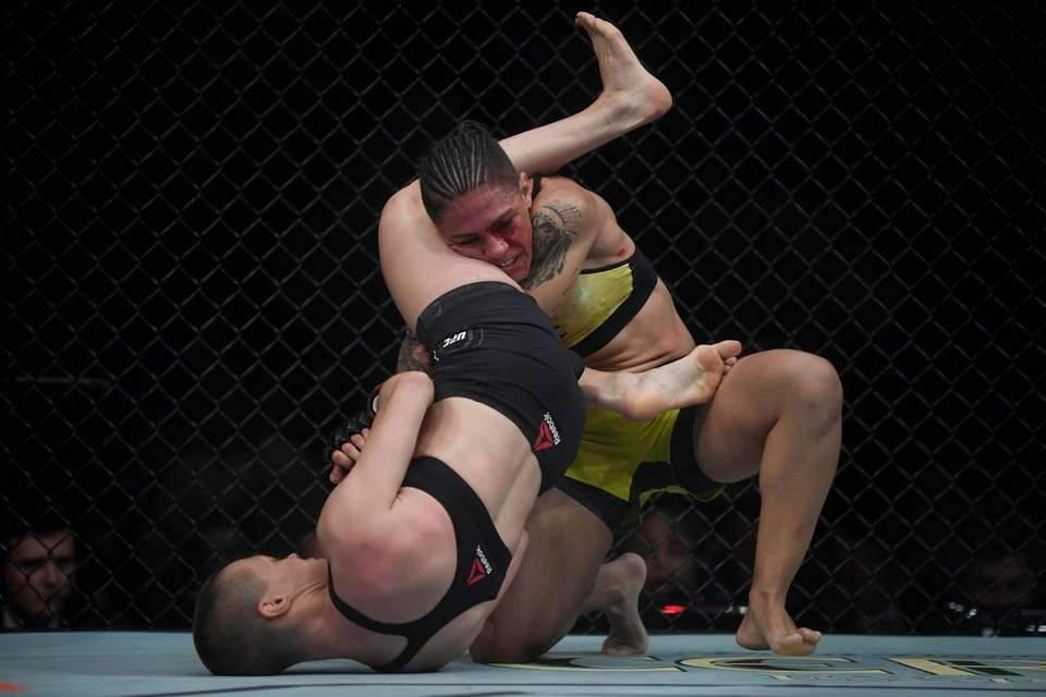 TOPSHOT - Brazilian fighter Jessica Andrade (R) competes