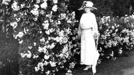 Mai Coe walks through the Italian Garden at