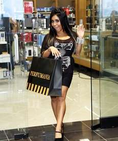"Nicole ""Snooki"" Polizzi coming out of Perfumania. (Aug."