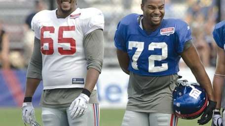 Will Beatty shares a laugh with Osi Umenyiora