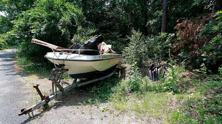 A boat with trailer, a wheelbarrow and other