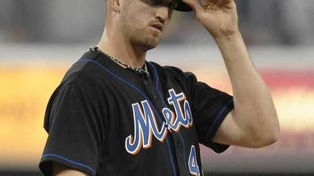 Jonathon Niese stands on the mound after giving