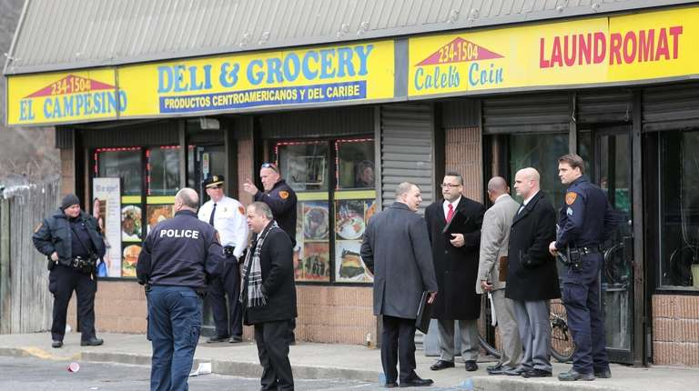 Suffolk County police investigate a shooting at 133