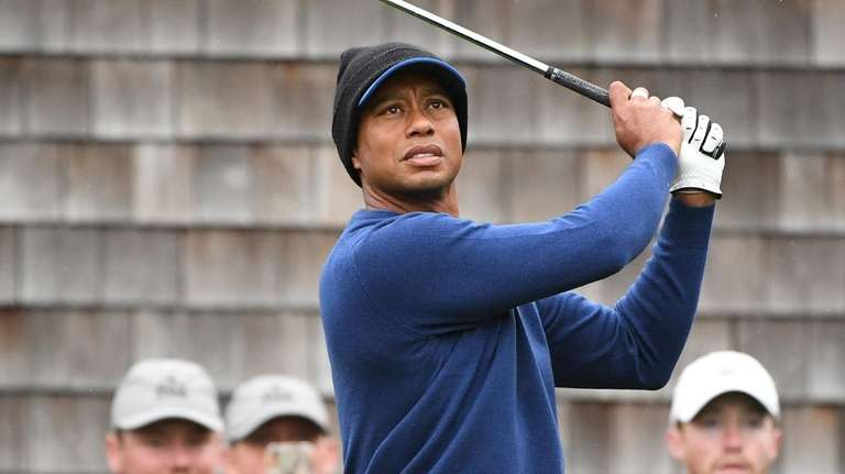 Tiger Woods tees off during the first day