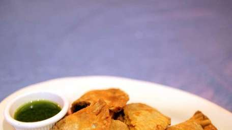 The shrimp, beef, and chicken empanadas are served