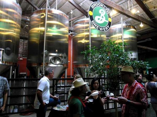 Visitors sample beer at the Brooklyn Brewery in