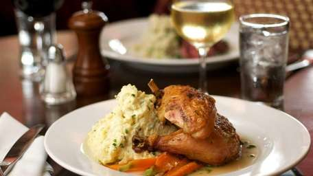 Herb-roasted chicken is served with country egg potato
