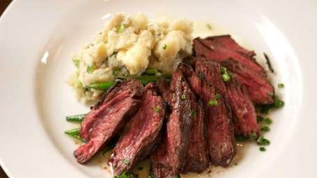Grilled hanger steak is served with Camembert-mashed potatoes,