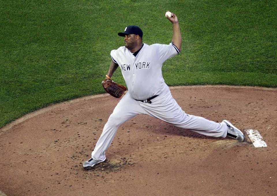 New York Yankees pitcher C.C. Sabathia throws during
