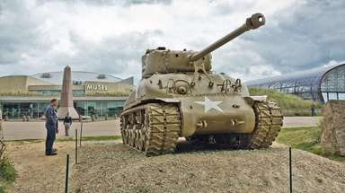 A Sherman tank guards the approach to the