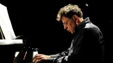 Philip Glass performs
