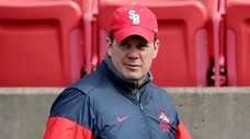 Stony Brook men's lacrosse head coachJim Nagle walks