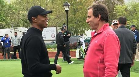 "Tiger Woods, left, and SiriusXM host Chris ""Mad"