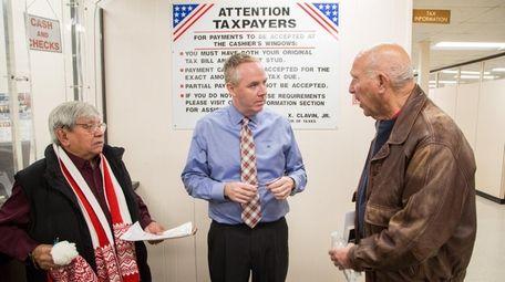 Hempstead Town Receiver of Taxes Donald Clavin, center,
