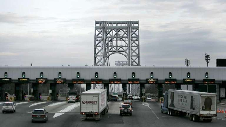Cars approach the toll booth at the George