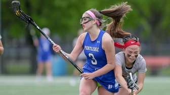 Ava Pascarella #3 of Portledge High School collides