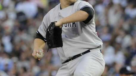 New York Yankees pitcher Phil Hughes throws against