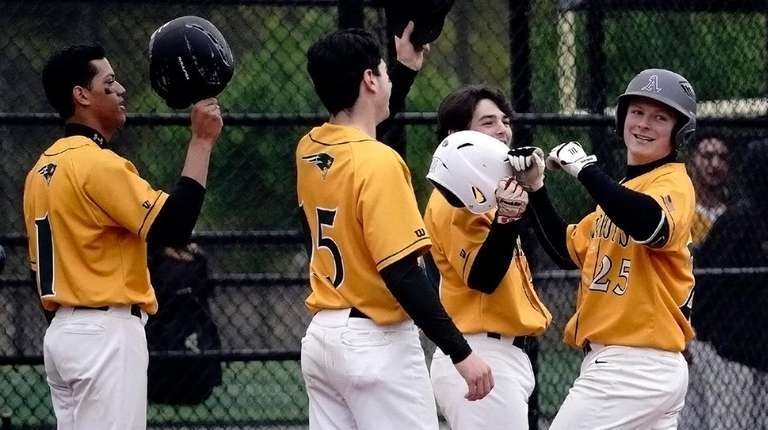 Ward Melville's Ryan Hynes, right, celebrates at home