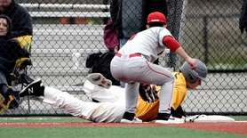 Ward Melville's Ryan Hynes is safe at third
