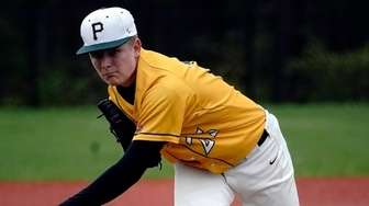 Ward Melville starting pitcher Ryan Hynes delivers against