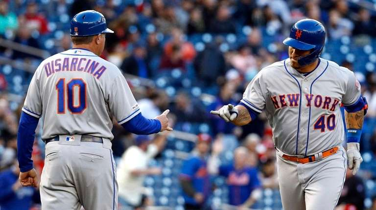 The Mets' Wilson Ramos, right, rounds the bases