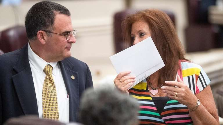 Rep. Terri Collins, right, chats with Rep. Chris