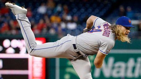 Mets starter Noah Syndergaard follows through on a