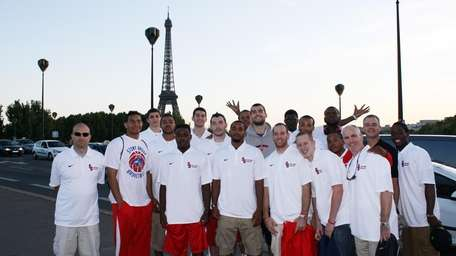 Stony Brook's men's basketball team stands in front