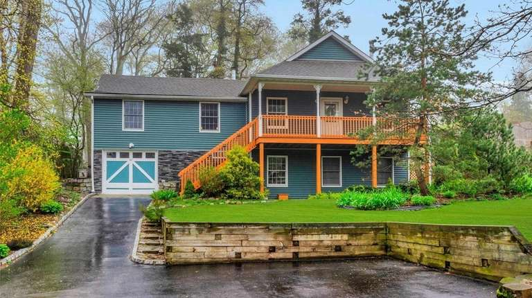 This three-bedroom, two-bath raised ranch is on a
