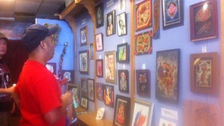 Peter Bune of Brooklyn looks at art on