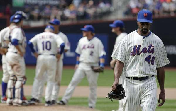 New York Mets relief pitcher Manny Acosta heads