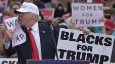 Republican presidential nominee Donald Trump kisses a