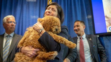 Nassau District Attorney Madeline Singas holds Bella the