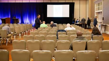 A sparse group of bidders gathered Wednesday at