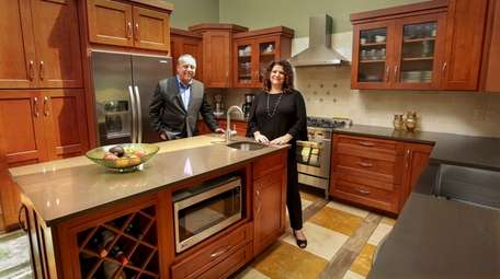 Randy and Dawn Novick in the kitchen of