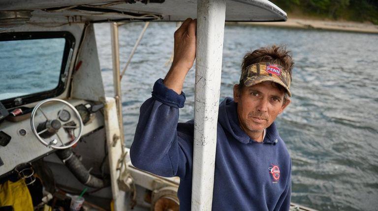 Clam fisherman Bryan Murphy stands on his fishing
