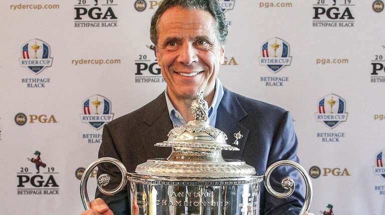 Gov. Andrew M. Cuomo with the Wanamaker Trophy,