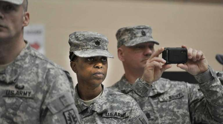 Lt. Col. Jackie Gordon, center leader of the