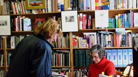 A customer browses inside Canio's Books on Main