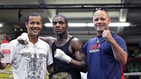 Titus Williams (Middle) poses with trainer Joe Higgins