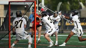 Chaminade's Michael O'Connell (12) shoots on goal against