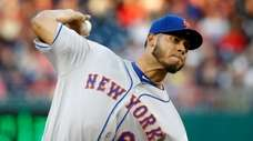 Mets starting pitcher Wilmer Font throws to the